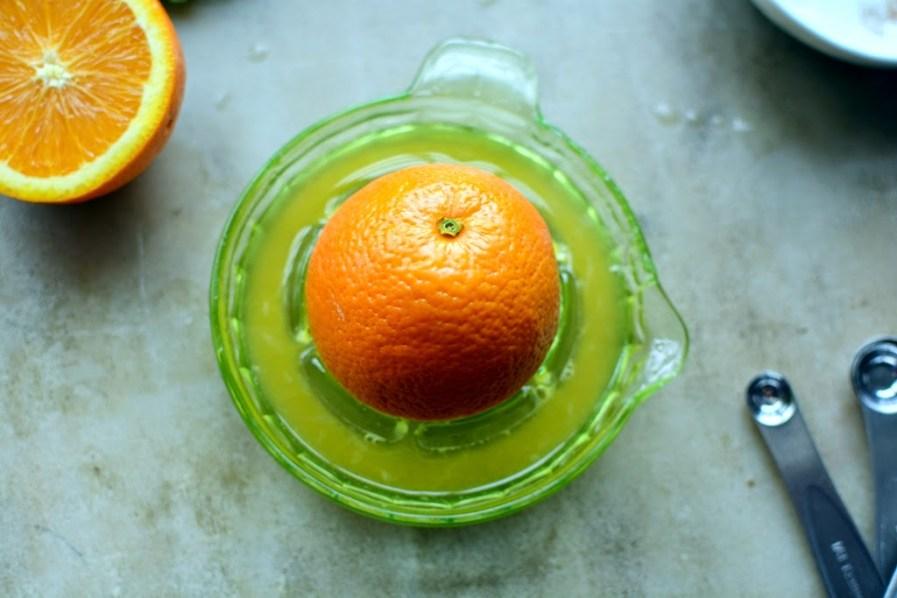 fresh orange on juicer