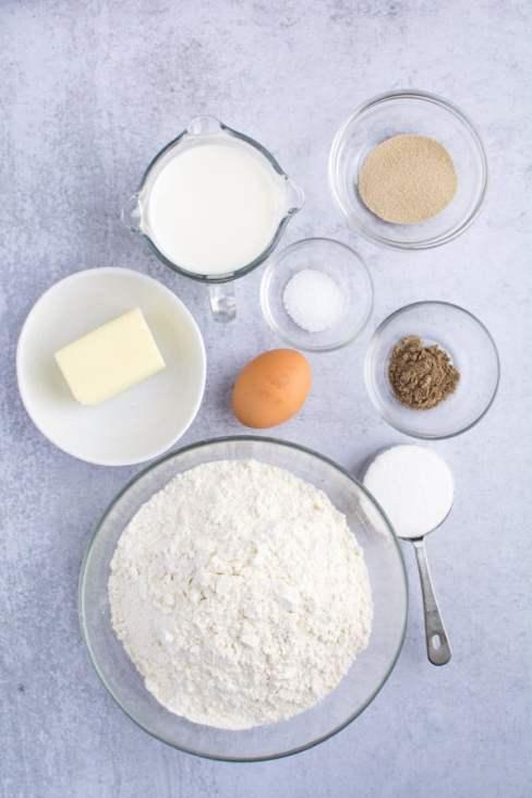 dough ingredients measured in bowls