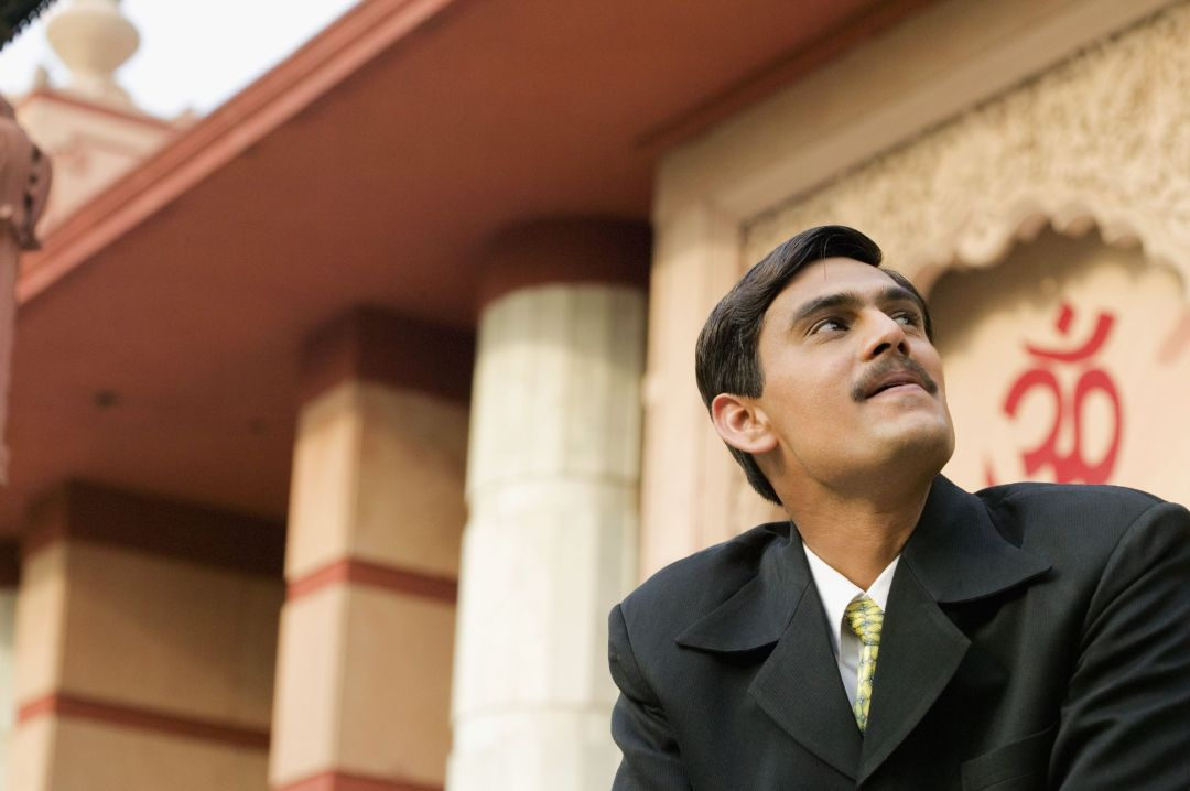 Low angle view of a young man looking up