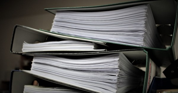 Stack of Binders Containing Thick Bundles of Papers