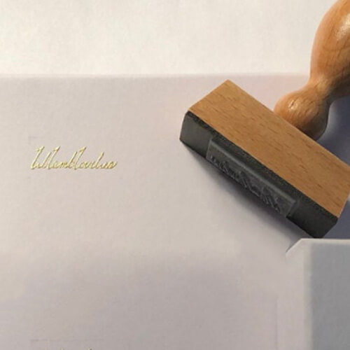 wood signature stamp with gold ink