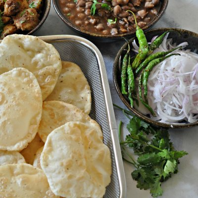 Chole Bhature : Spicy Chickpea Gravy Served With Fried Bread