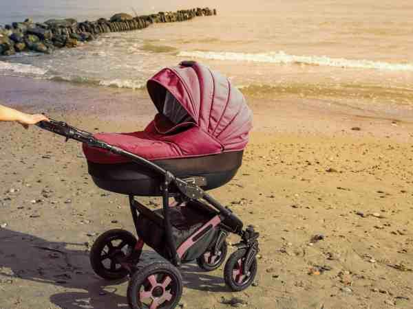 A stroller strolls in the seaside. toned photo