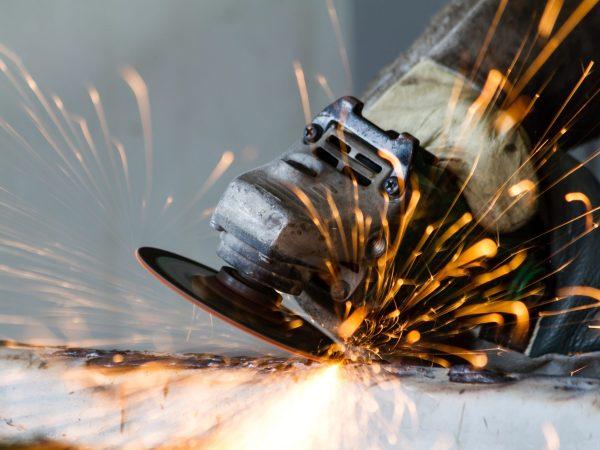 19143626 – metal grinding on steel pipe close up