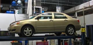 Car in emissions testing facility