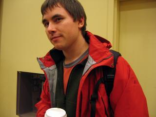 Milan Ilnyckyj in a red coat