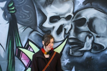 Emily Horn, looking sad with some skulls