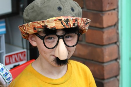 Kid with a fake nose and glasses