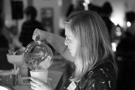 Woman pouring water at Raw Sugar