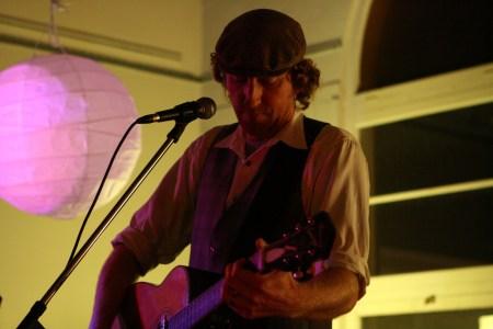 Guitar playing man