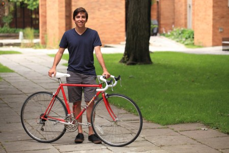 Adam Mosa with red bicycle