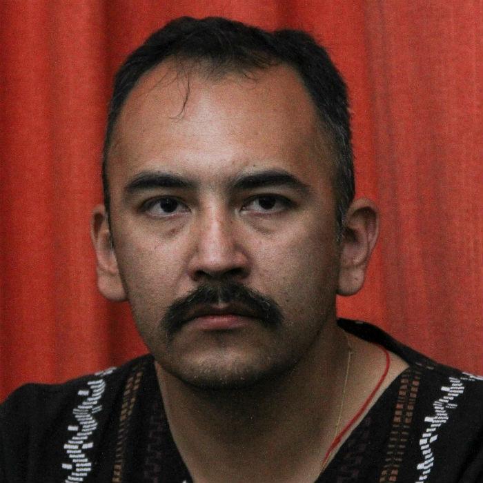 El activista Juan Carlos Flores Solís durante la conferencia después de 10 mesas de estar encarcelado. Foto: Cuartoscuro