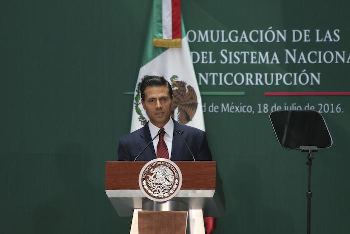 """El Presidente Enrique Peña Nieto promulgó hoy el Sistema Nacional Anticorrupción en medio de las críticas por pedir perdón después de encontrarse la """"Casa Blanca"""" de su familia. Foto: Cuartoscuro"""