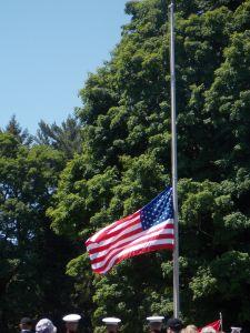 US Military salute flag at half mast