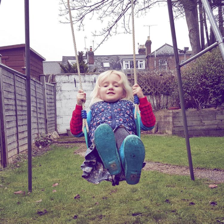 new swing in the garden with frozen wellies
