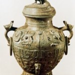 A Western Zhou dynasty bronze utensil- a lei (a kind of ancient wine vessel) with a lid and coiling dragons pattern