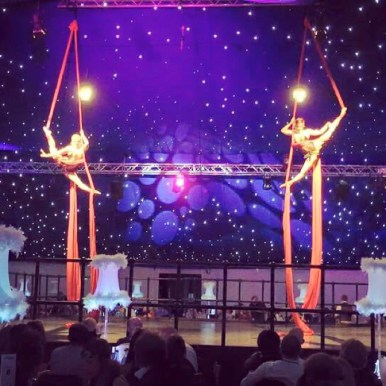 Synchronised aerial silks performance