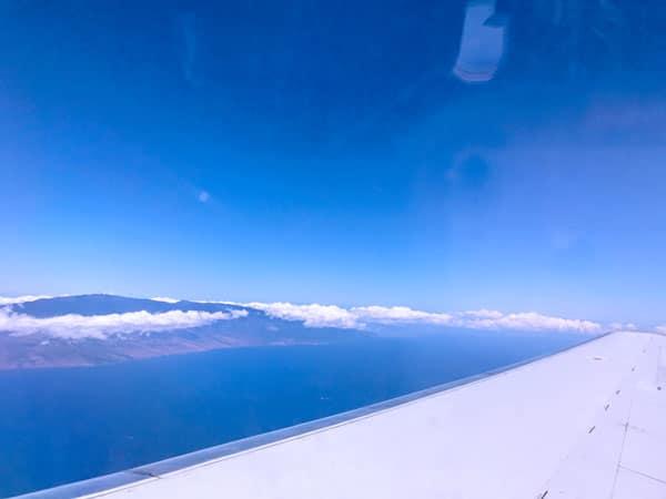 Hawaiian airplane from Kona Big Island flight to Maui airport looking out the Hawaiian plane window