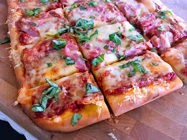 Making pizza at home with store bought dough