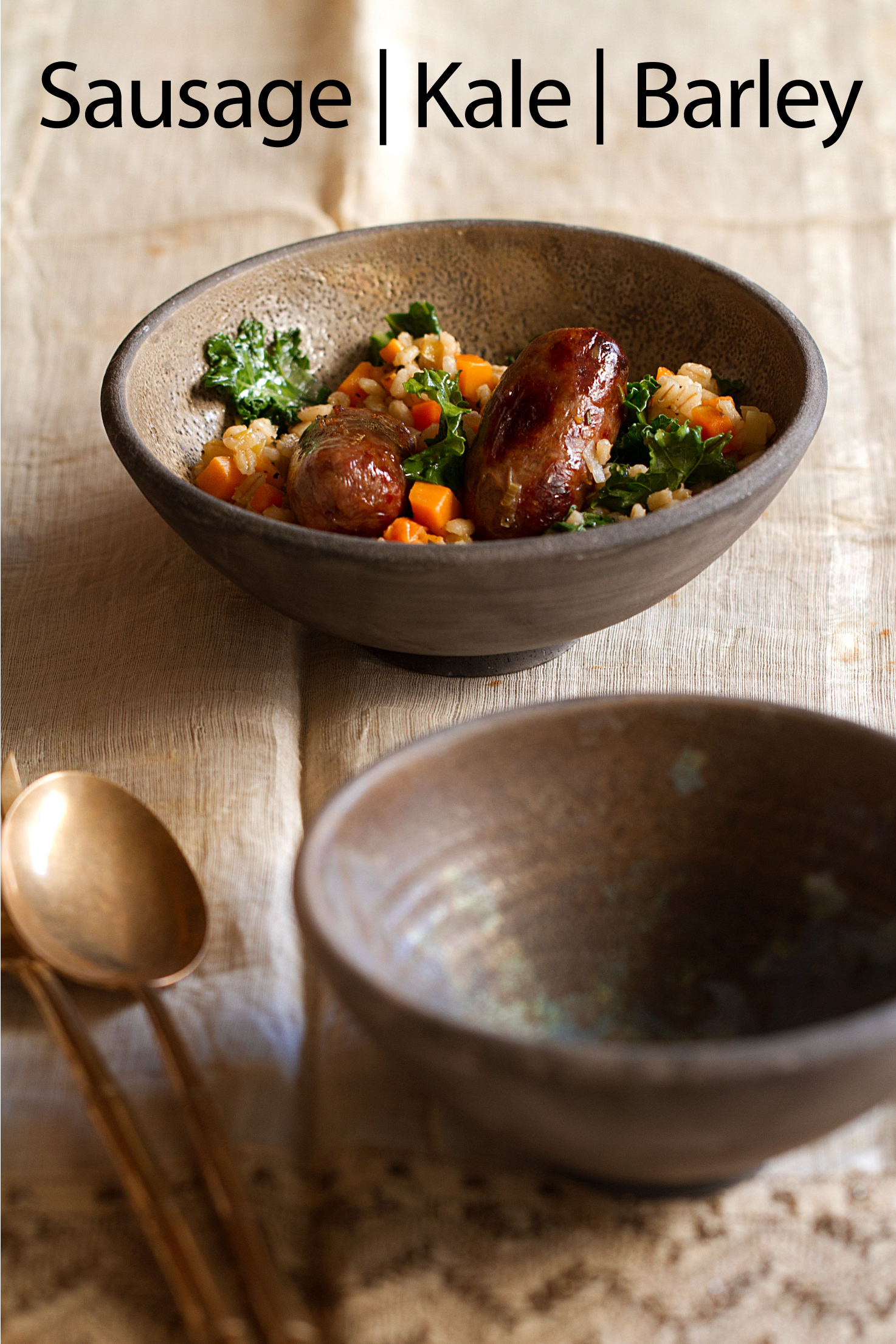 Italian Sausages Cooked in the Oven and Served in a Stew with Kale and BarleyItalian Sausages Cooked in the Oven and Served in a Stew with Kale and Barley
