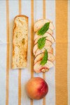 Peach and Camembert Baguette with Basil and Black Pepper