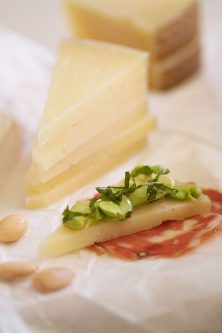 Raw Fava and Mint on Manchego Cheese with Salami Slices