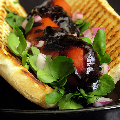 Grilled sausage with blackberry ketchup & watercress