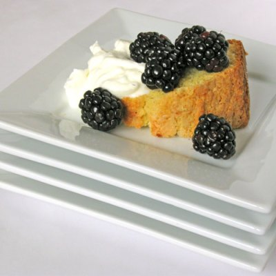 cornmeal cake with berries and cream