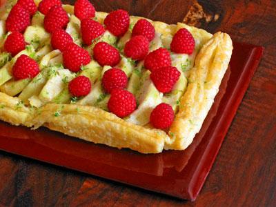 cherimoya tart with lime zest and rasberries
