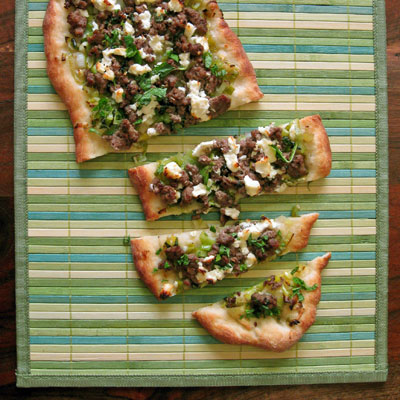 flatbread with lamb, onions mint and feta