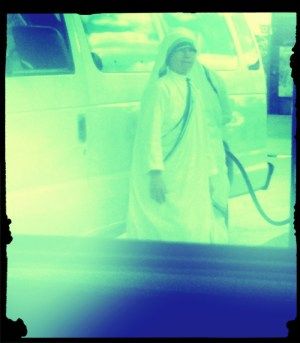 Mother Teresa pumping gas