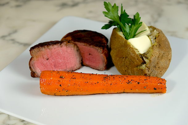 Steak house carrots on the grill