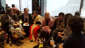 women sitting in a seni circle with wonan in a wheelchair at the end