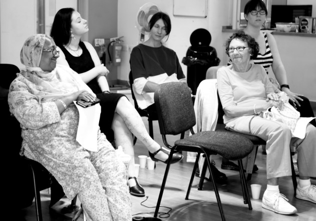 participants - forefront 2 older women, one white and one Asian, smiling at each other