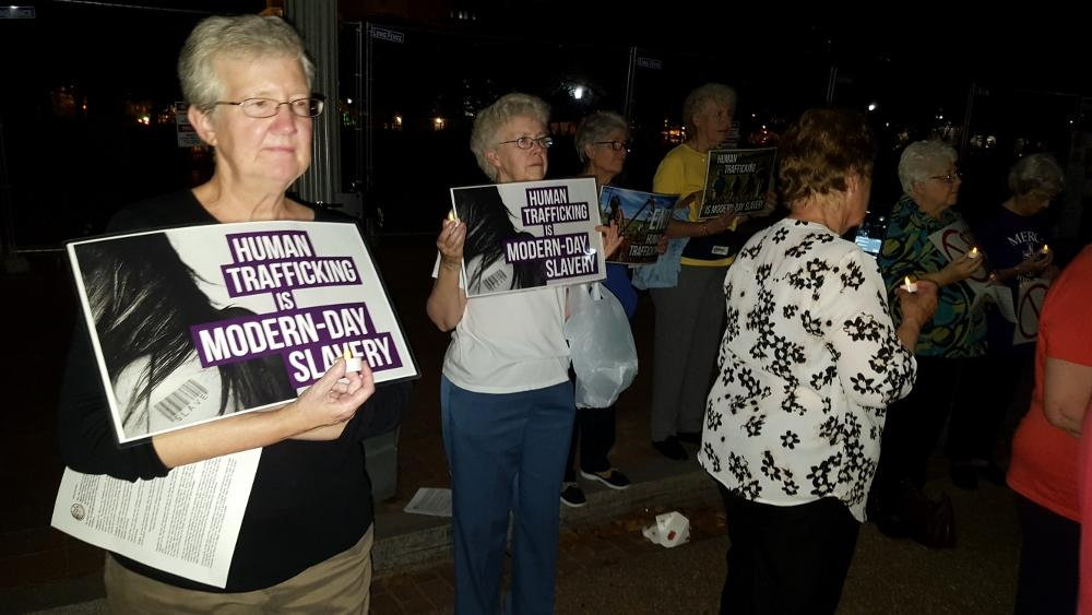 U.S. Catholic Sisters Against Human Trafficking pray outside of the White  House in Washington, D.C., Oct. 9. (Michele Morek)