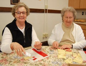 Sisters Jackie Goodin and Cecilia Nagel do their part.