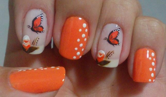 unha decorada com borboletas