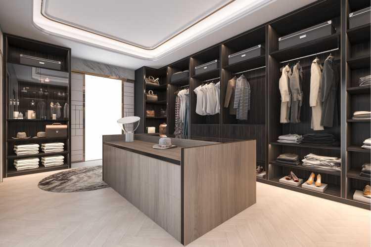 closet escuro com bancada central bem iluminado