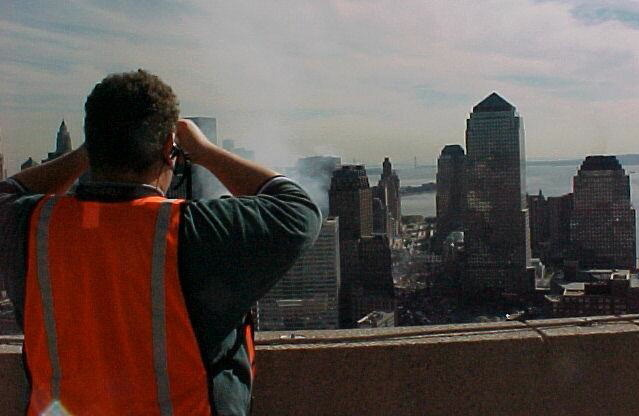 On the rooftop of the Traveller's Building two days after the 9/11 attack. Steve and his team helped Verizon bring over a microwave feed from New Jersey and deploy 26 portable cell sites in Lower Manhattan to support the rescue and recovery efforts.