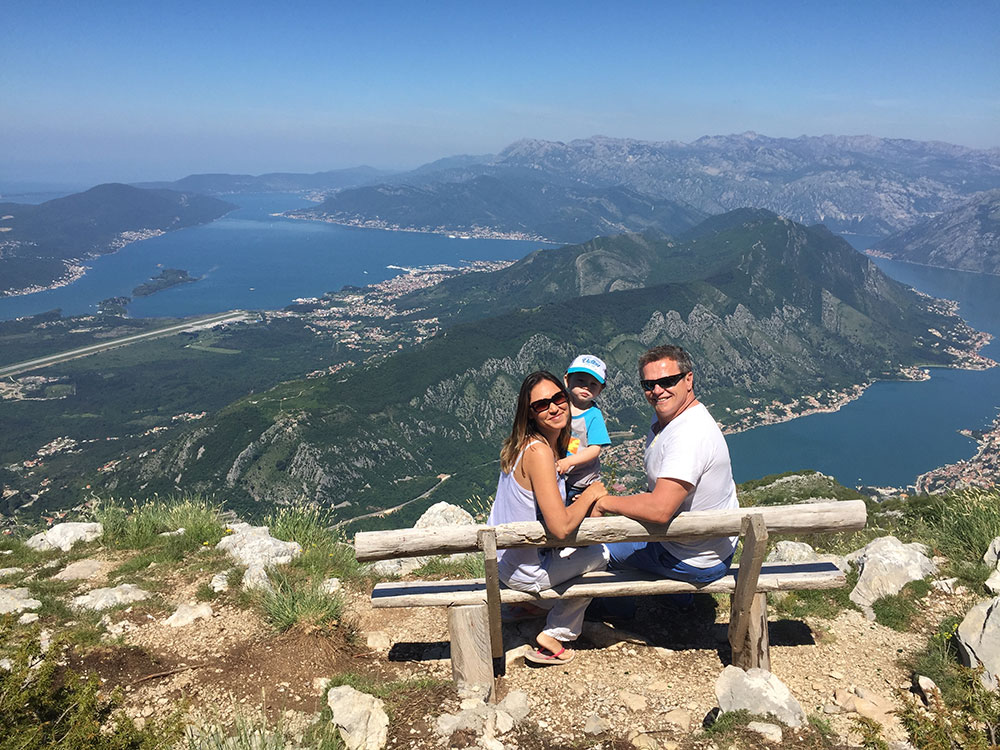 Exploring the Bay of Kotor, Montenegro, with her husband and son.