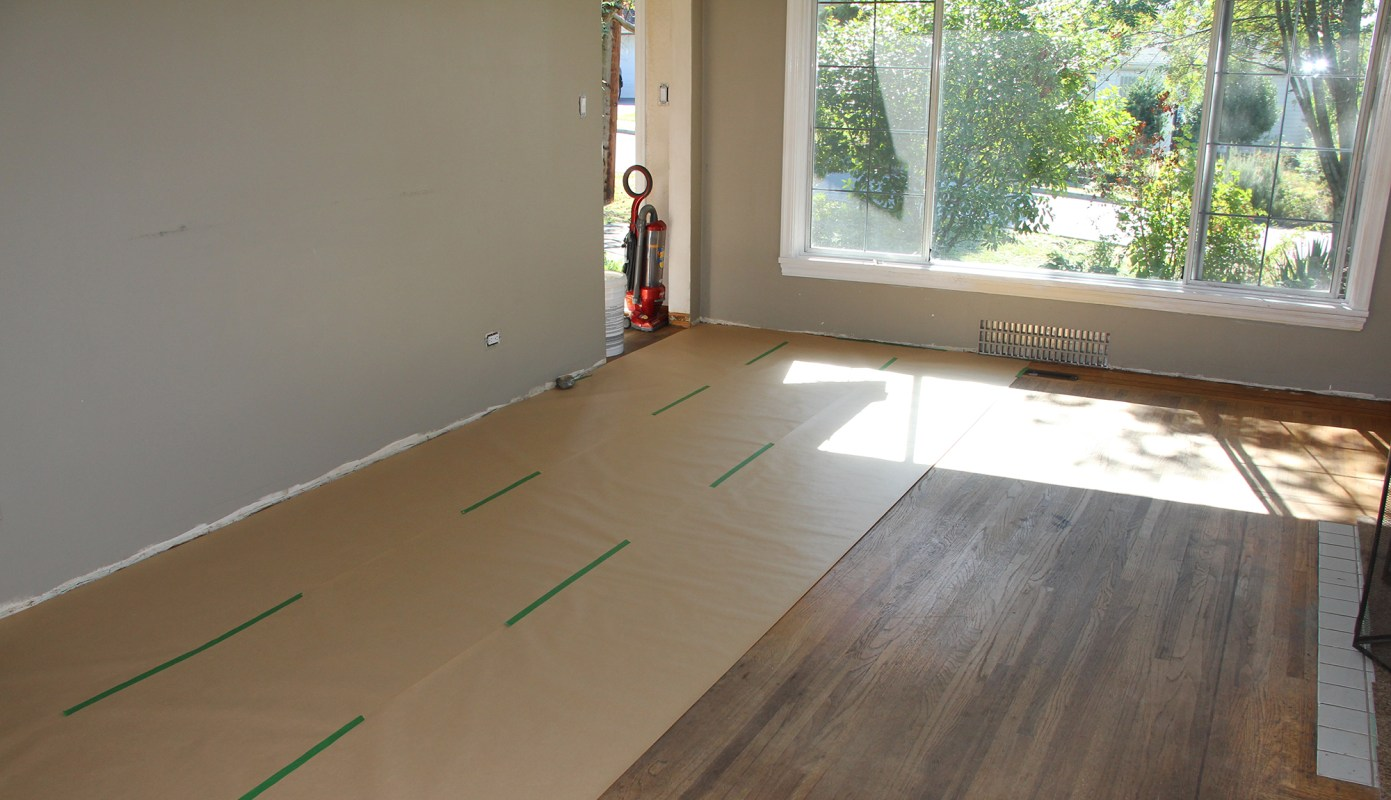 Covering our hardwood even tho it is in rough shape...we don't want it rougher