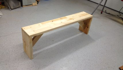 Adam made a 2x4 bench out of the scraps from the basement demo