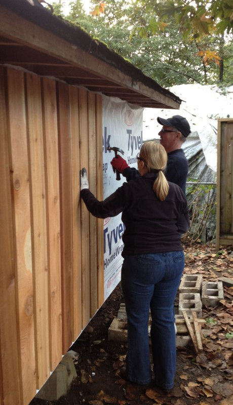 Mom and dad putting up siding.