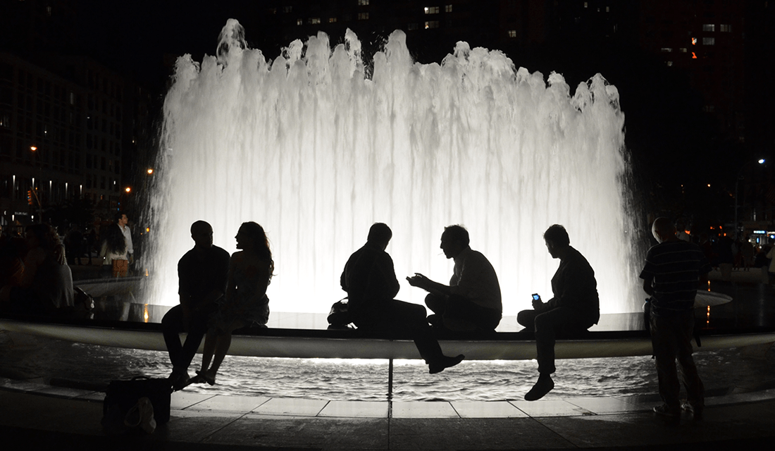 People Sitting by Fountain