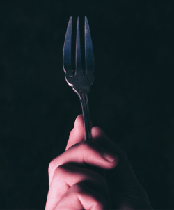 Person Holding Fork