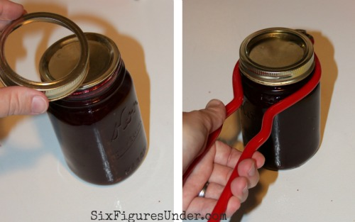 Put your hot flat lid on your clean jar rim, then screw on the ring. Use the jar wrench to hold the hot jar and screw the band on tightly