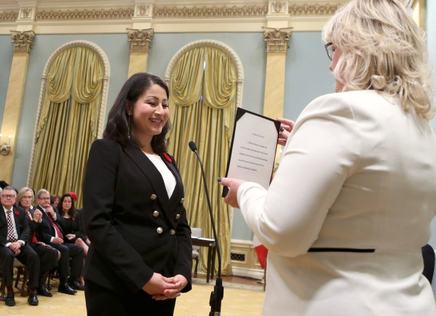 Canada's new Democratic Institutions Minister Maryam Monsef is sworn-in during a ceremony in Ottawa