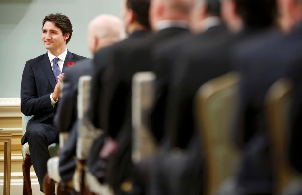 Canada's new Prime Minister Justin Trudeau applauds during a swearing-in ceremony at Rideau Hall in Ottawa