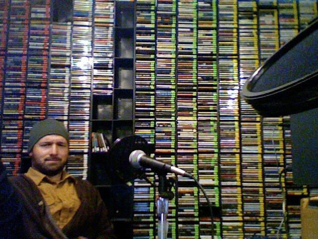 Saint John on a radio show, skowling.