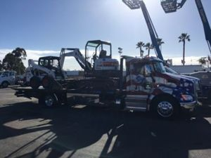 gallery- flatbed truck hauling equipment